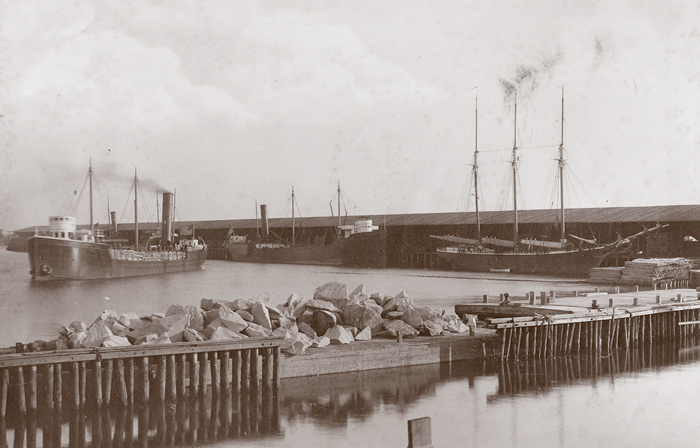 Historic photo of lumber ships.